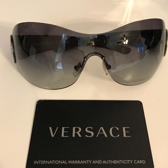 b76788d2799 Versace rhinestone sunglasses. M 5aa28e911dffda8eb6932979. Other Accessories  ...